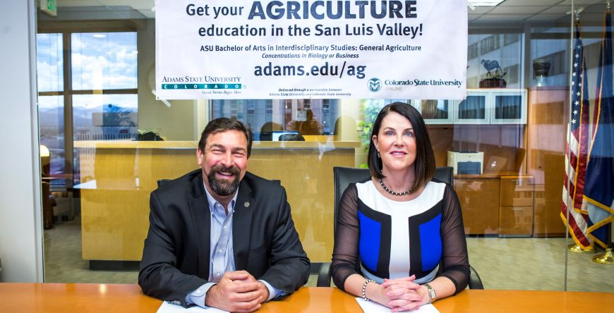 Colorado State University President Tony Frank and Adams State President Beverlee McClure sign the MOU for a new degree program in agriculture.