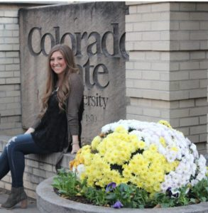 Portrait of Taylor Sloan in front of CSU sign