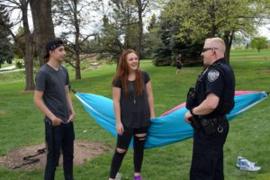 A CSUPD officer interacts with students on campus.