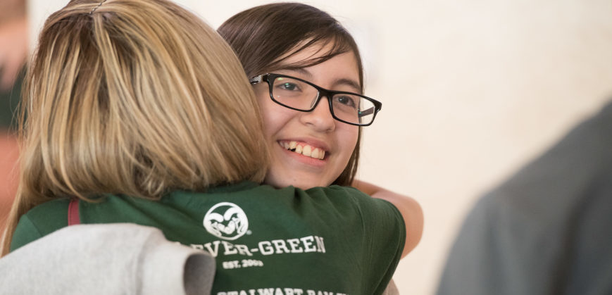 Student gets hug from adviser in Rams t-shirt