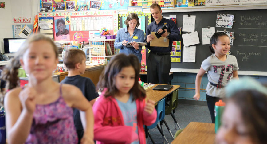 College students observe children in a classroom