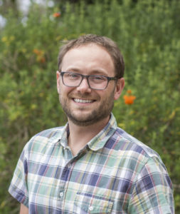 color photo headshot of researcher Nate Grubaugh, CSU alumnus