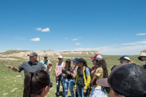 color photo of CSU's John Moore and students at Pawnee National Grassland