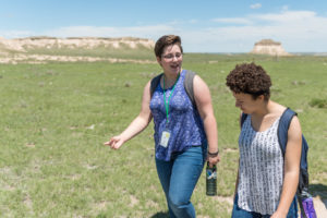 Color photo of two high school students at Pawnee National Grassland