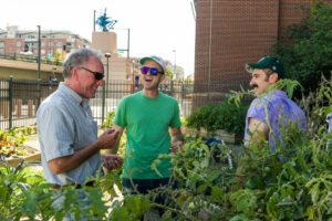Brian Dunbar with students harvesting the sustainable GaRden at Coors Field.