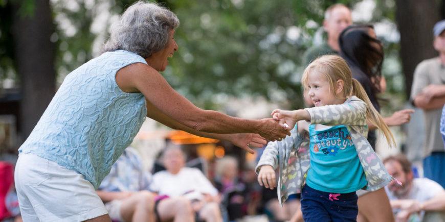 A woman and little girl dance at Lagoon Summer Concert Series