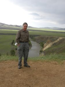 Robin Reid standing on the banks of the Orkhon River, Bat Ulziit, Mongolia.