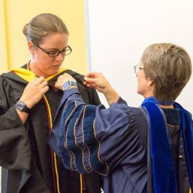Online student affairs graduate gets a commencement of her own
