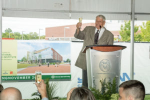 color photo of John Malone, giving a toast at groundbreaking event