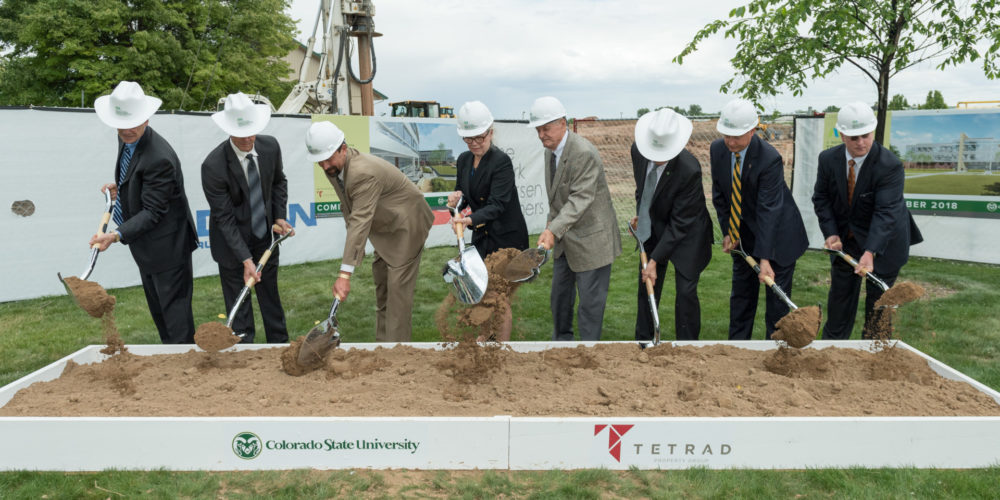 color photo of donors, university leaders at groundbreaking event with shovels