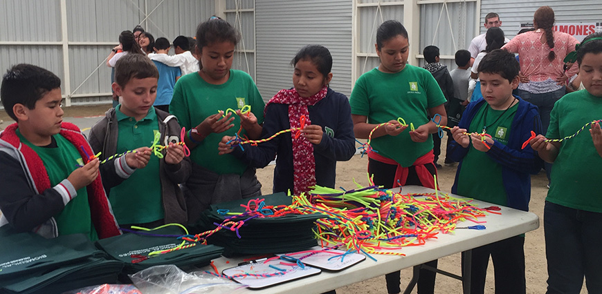Children make pipecleaner crafts in Todos Santos