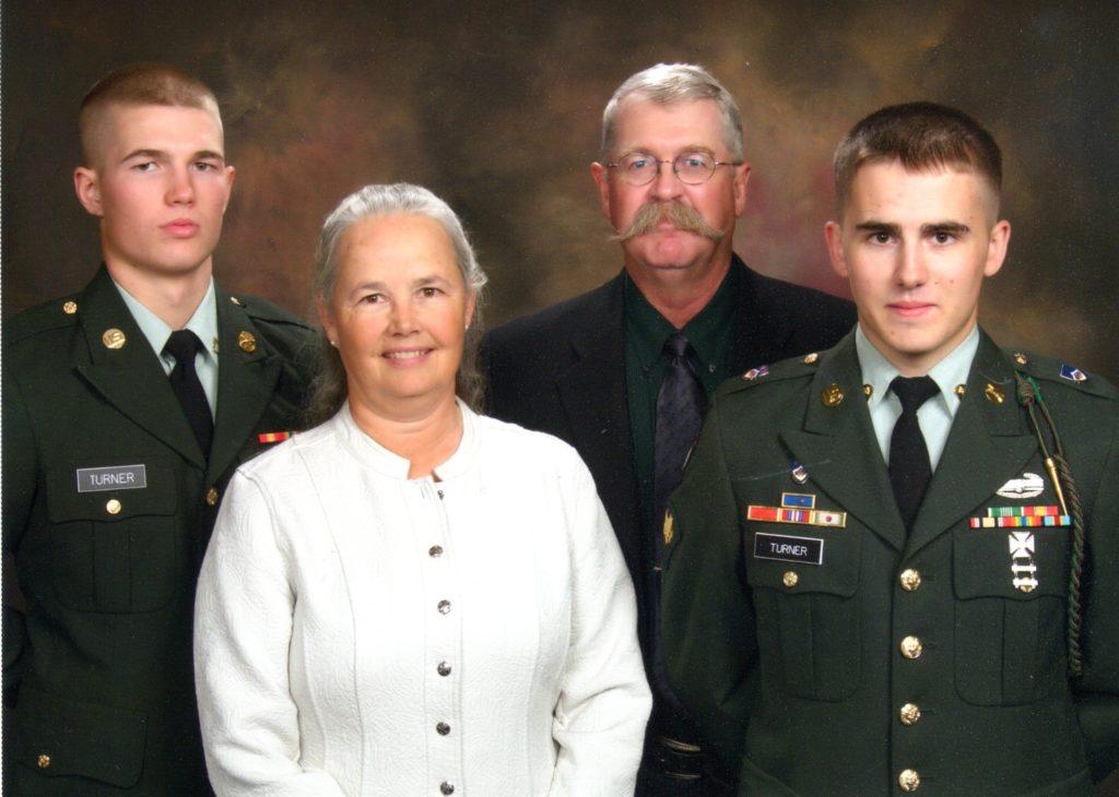 Family photo of Tristan Turner, Dr. Julie Wilson, Dr. Tracy Turner, and Tarren Turner