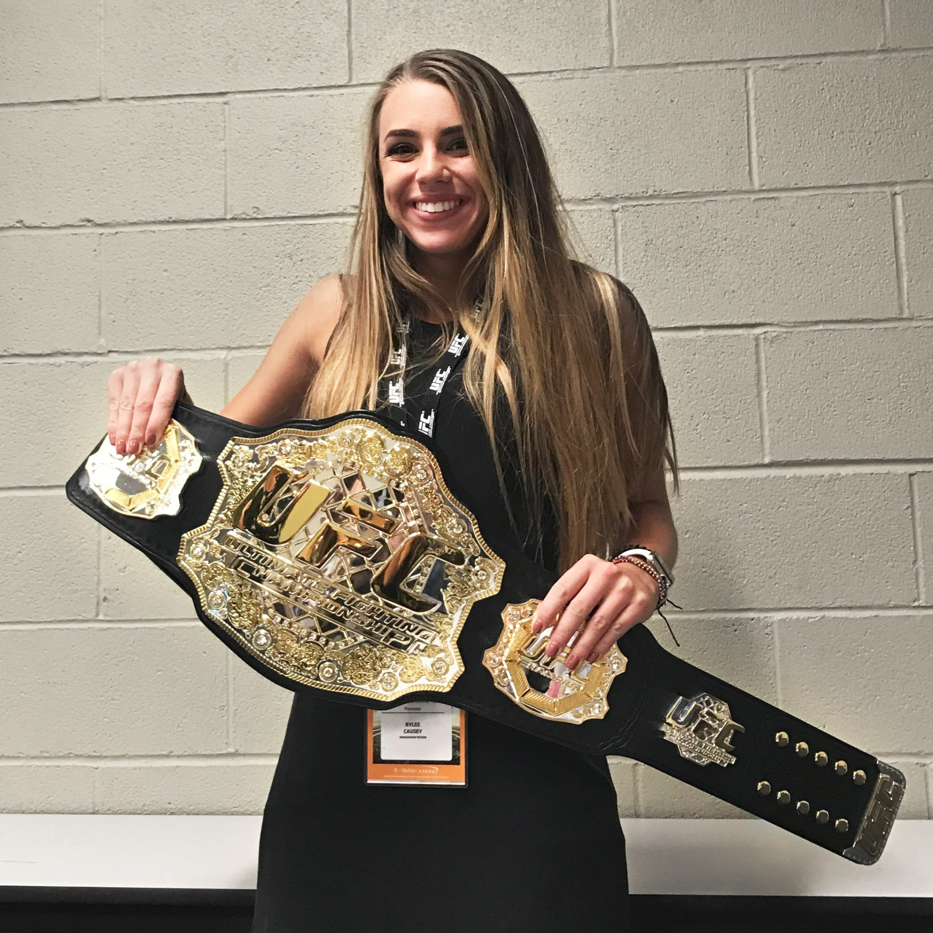 Rylee Causey holds UFC championship belt