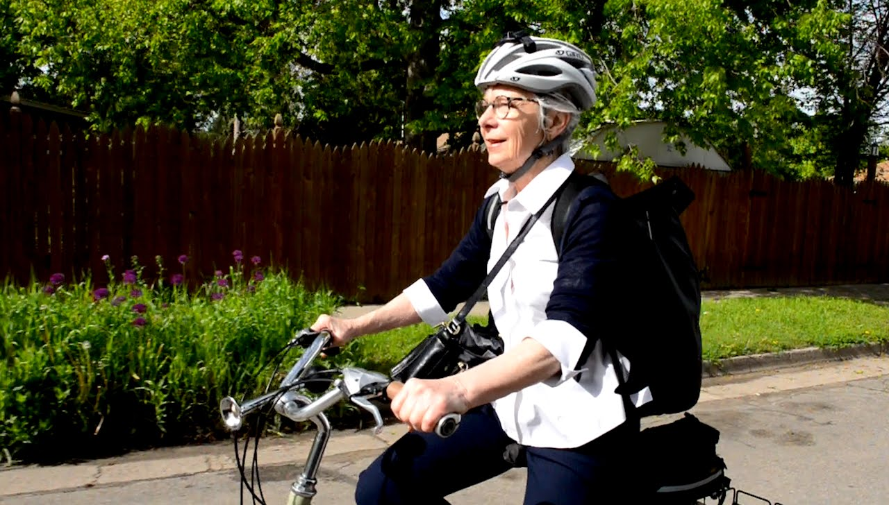 Woman in bike helmet riding