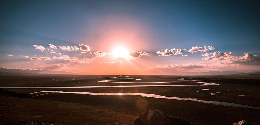 sunlight over a winding river