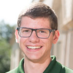 Colorado State University Human Development and Family Studies student and Admissions Ambassador Andrew Vanden Broeke poses in front of Ammons Hall