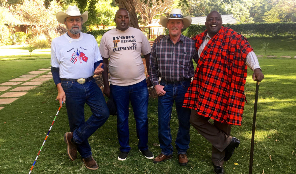 a color photo of a team of 4 researchers in Kenya