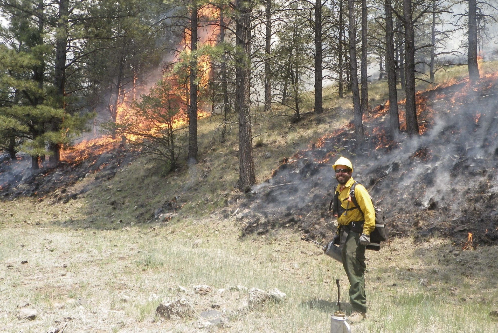 man in wildland fire PPE with drip torch