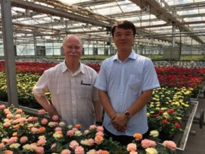 Lou Swanson tours private industry partner operation in Shenyang Province, China.