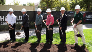 color photo of CSU leaders, construction reps with shovels at groundbreaking for the Health Education Outreach Center