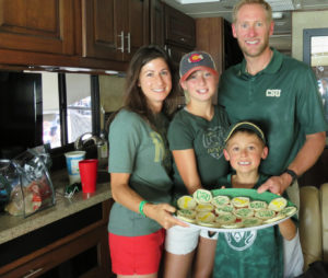 color photo of the Meadows family in their RV before CSU's first football game