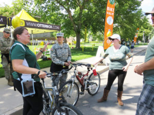 color photo of Mayah Plucinski, CSU student and Army ROTC member, helping at the bike valet at CSU's first football game
