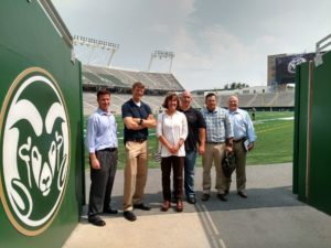 Tracy Nelson with members of 10th Special Forces Group (Airborne) and U.S. Army Special Operations Command touring the new stadium.