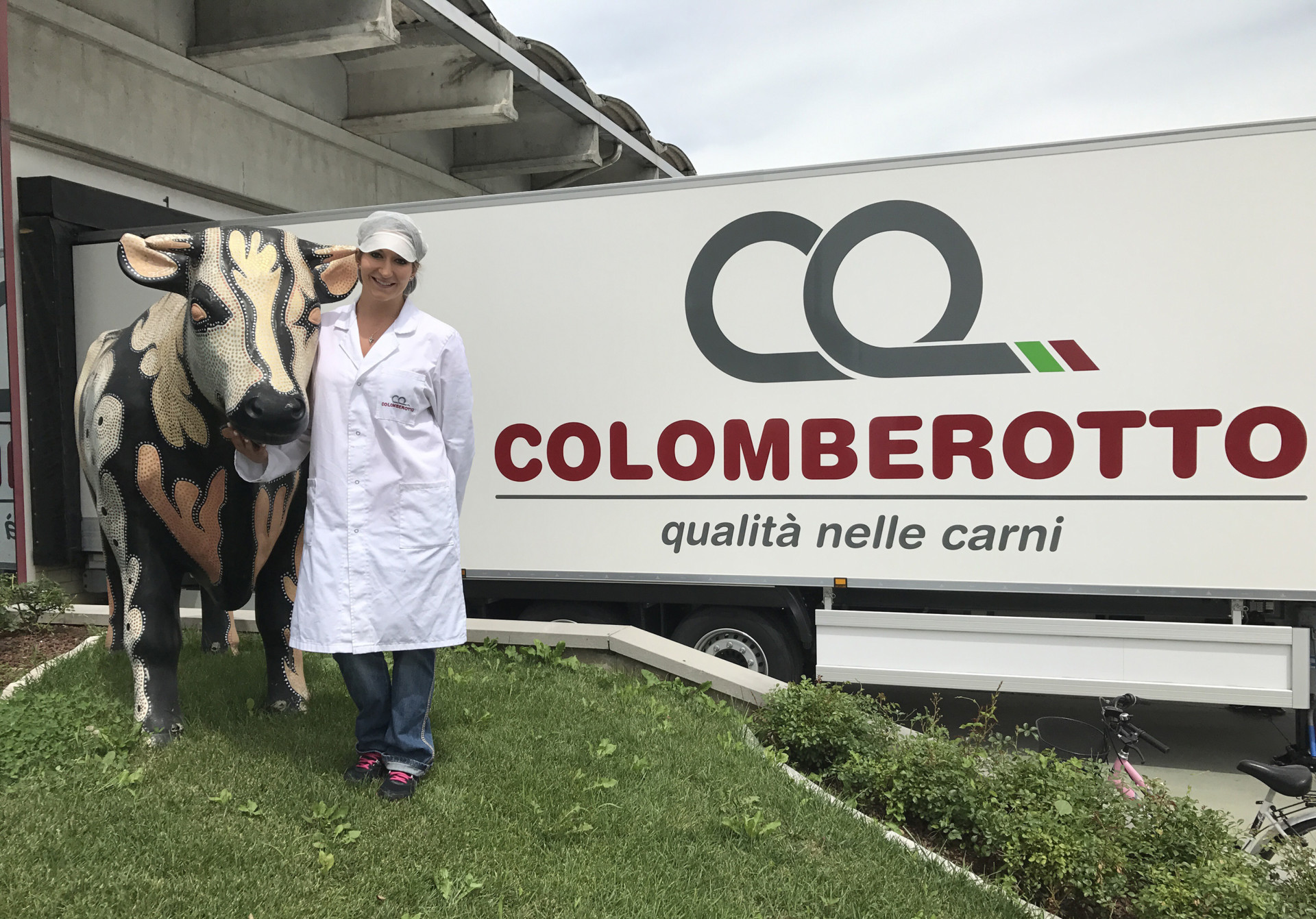 Malinda DeBell at meat plant in Italy