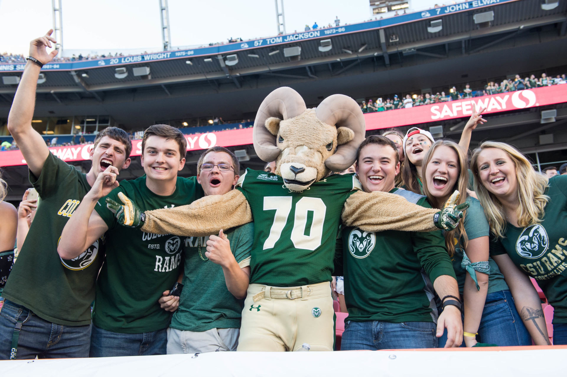 CAM the Ram mascot with students at Mile High Stadium