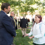 color photo of CSU President Tony Frank talking with a community member