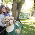 color photo of CSU mascot Cam the Ram with students
