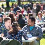 color photo of people eating a picnic lunch on the Oval