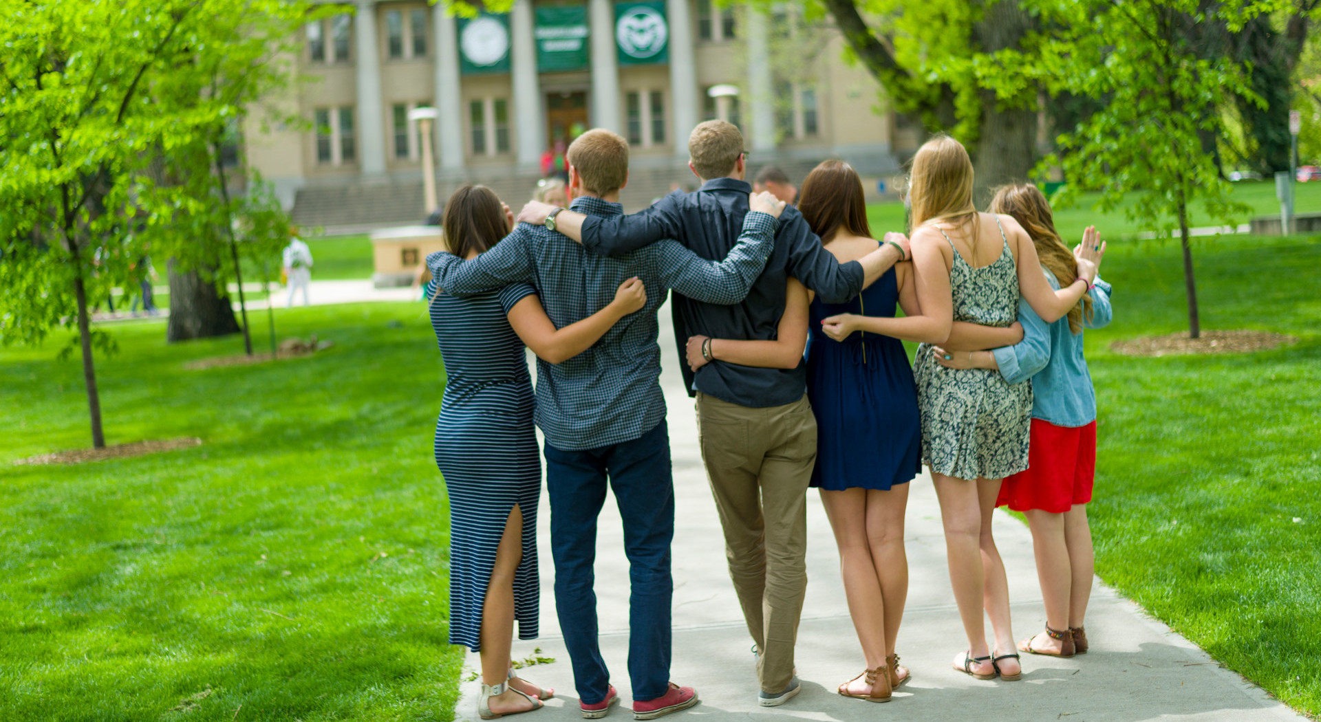 Graduating students gather with friends and family on the Colorado State University Oval in preparation for commencement ceremonies.