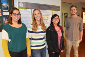 color photo of students from CSU's Student Sustainability Center in front of a research poster