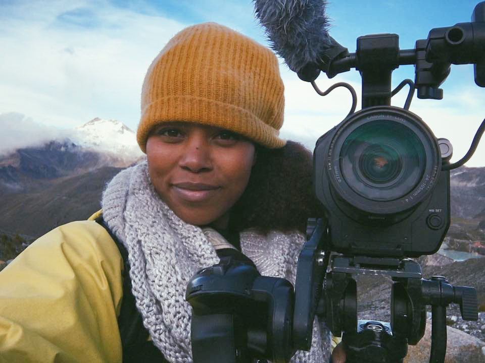 Haimy Assefa with Camera in the mountains