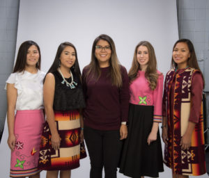 Cheryle Iron with students modeling her designs