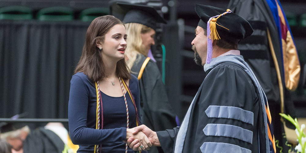 Kate McNealy shakes hands with CSU President Tony Frank
