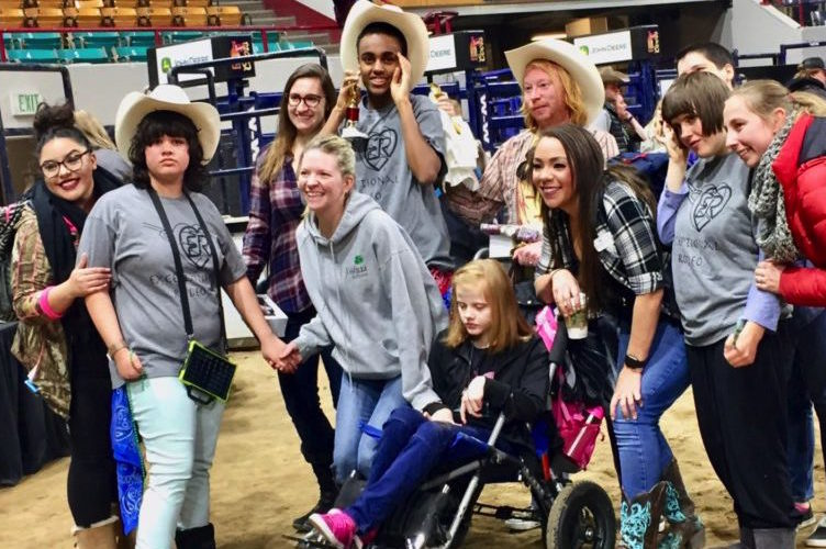 Exceptional rodeo participants pose for group photo.