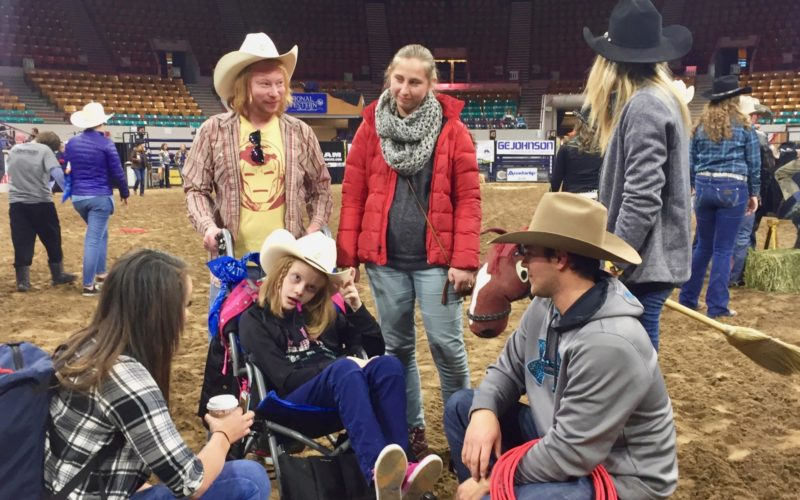 Exceptional Rodeo participant from The Joshua School with cowboy, teachers, and chaperones.