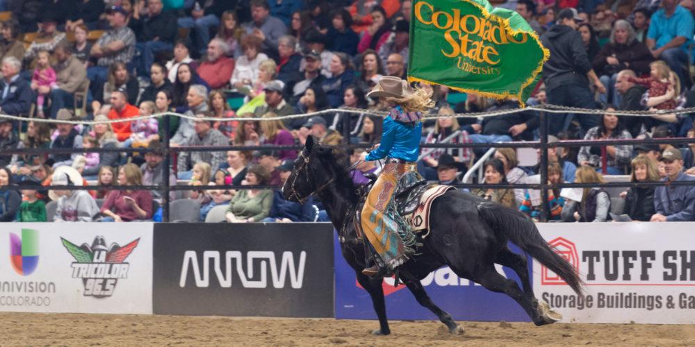 Rider with CSU banner