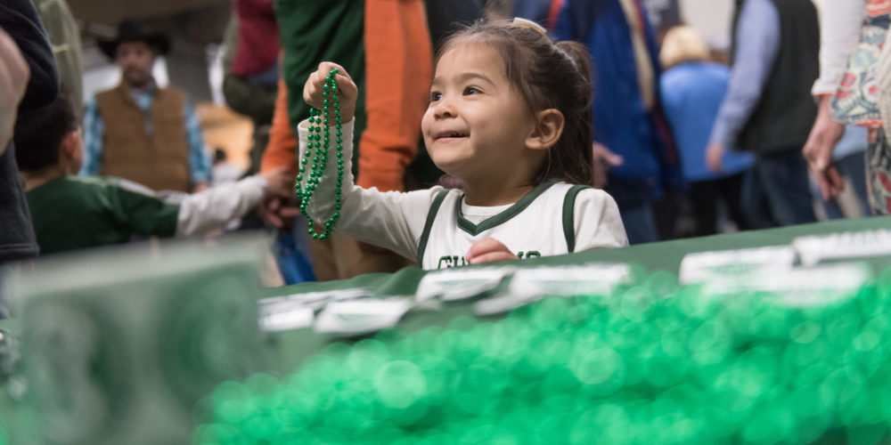 Little girl with beads at CSU booth