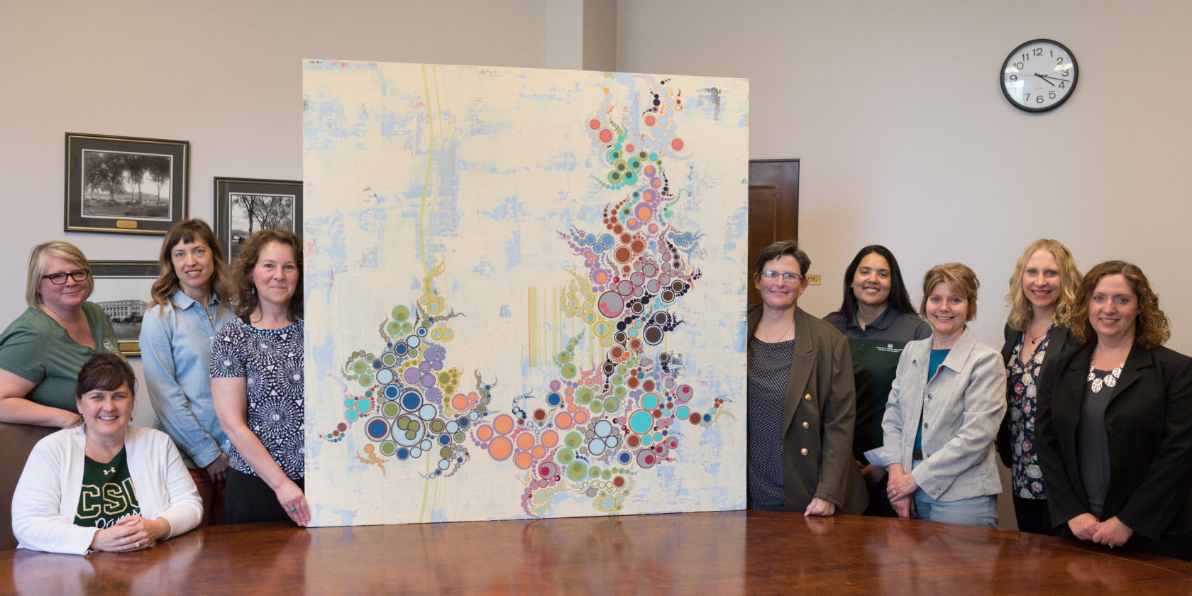President's Commission on Women and Gender Equity receives painting form Amelia Caruso
