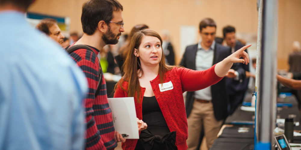 Student explains her poster at Demo Day 2018