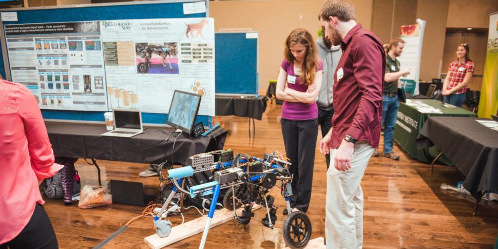 Student examine prototype at Demo Day 2018