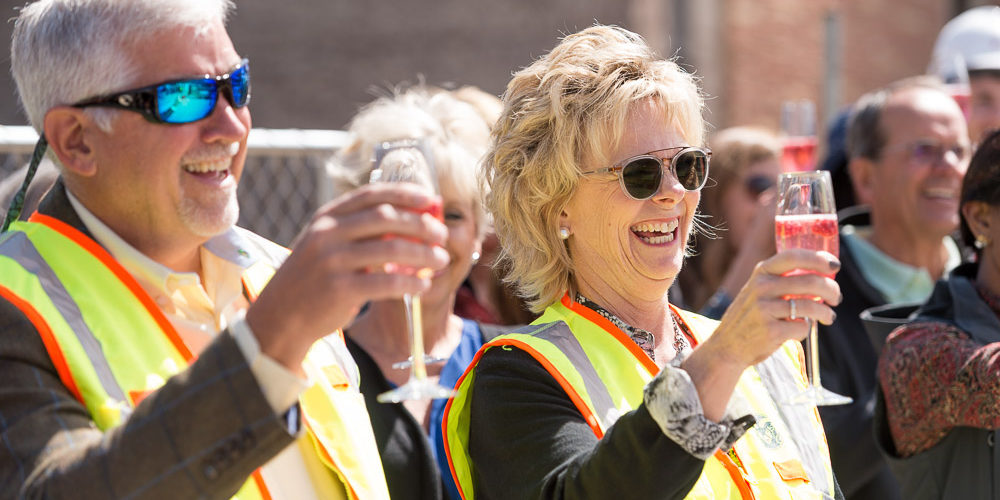 Curt and Nancy Richardson toast raising of the beam on design center
