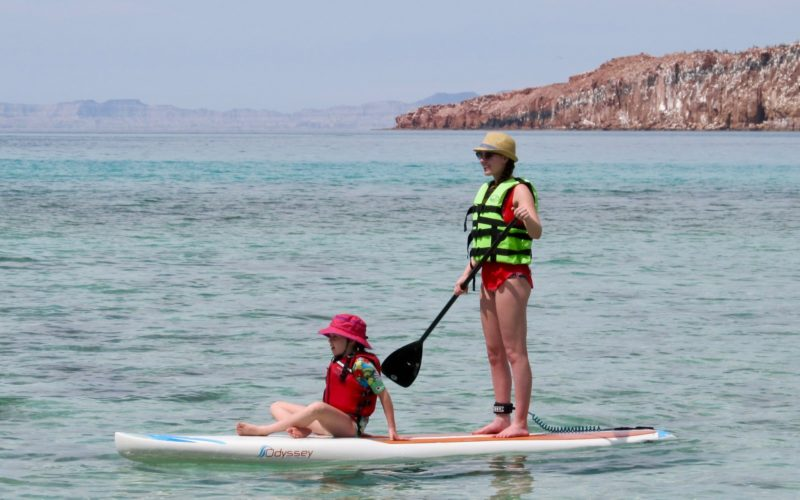 Todos Santos Center Family Adventure Week participants paddleboarding.