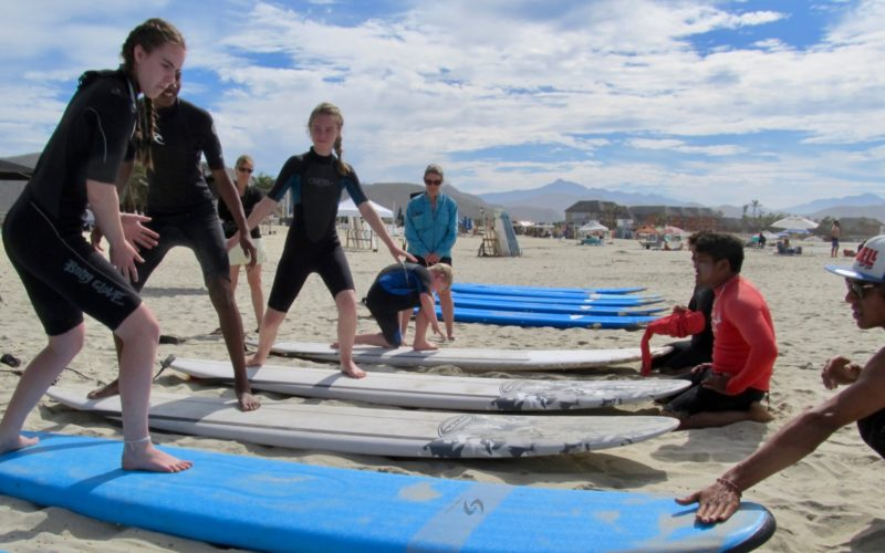 Todos Santos Center Family Adventure Week participants practice paddleboarding.