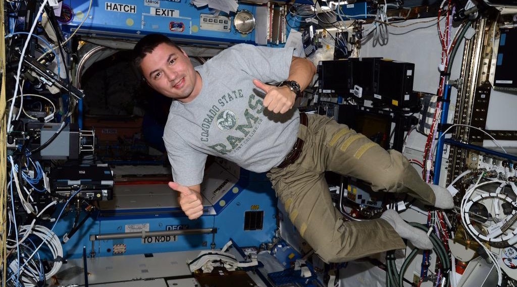 Kjell Lindgren wearing CSU shirt in space