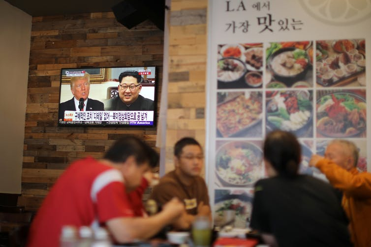 Trump and Kim Jong Un on TV