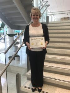 Stephanie Tomasini poses with Everyday Hero Award